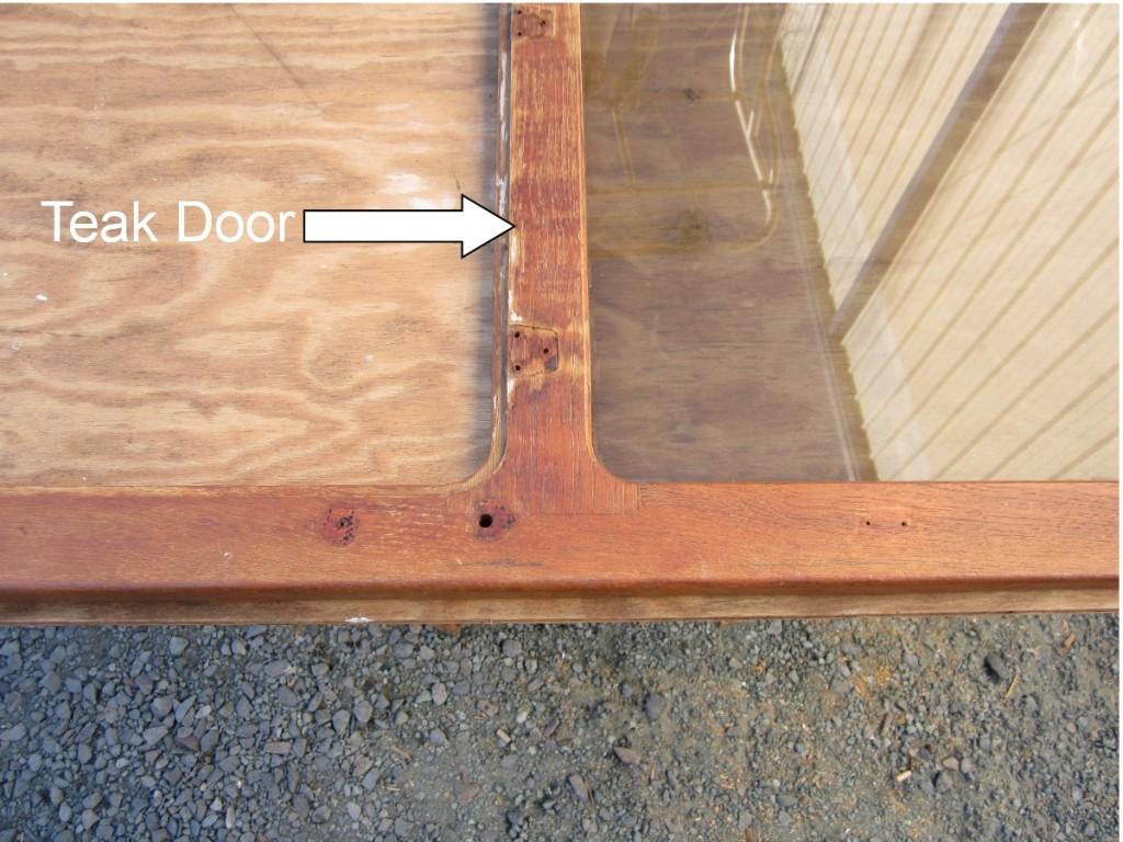Teak Door Being Sanded