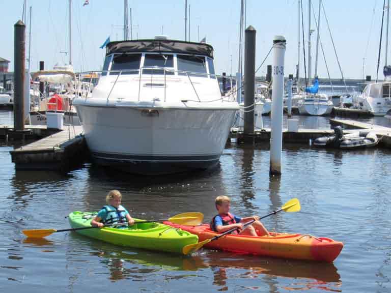 Kayaks being paddled between A&B docks